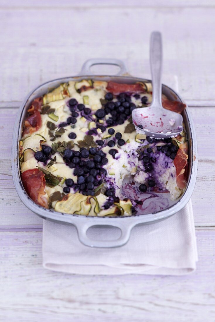 Wild blueberry and feta bake with bacon in an ovenproof dish