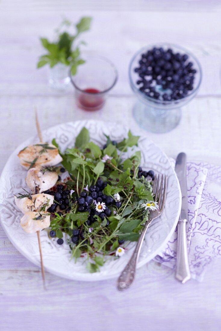 Wild blueberry salad with chicken breast