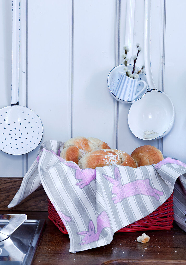 Pastries in bread basket lined with bunny-patterned cloth