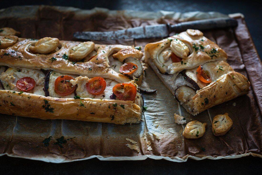 Vegan puff pastry pie with aubergine, scrambled tofu and tomatoes