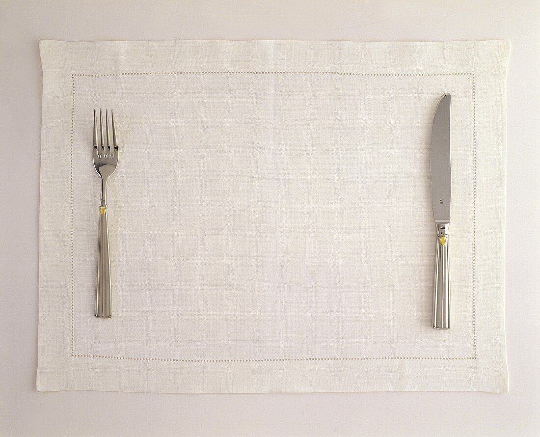 Place Setting with Fork and Knife on Placemat