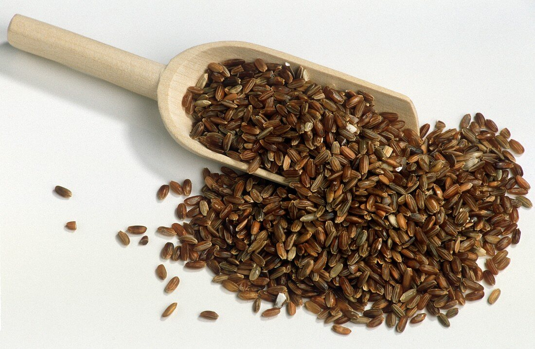 Natural Red Rice in Wooden Scoop
