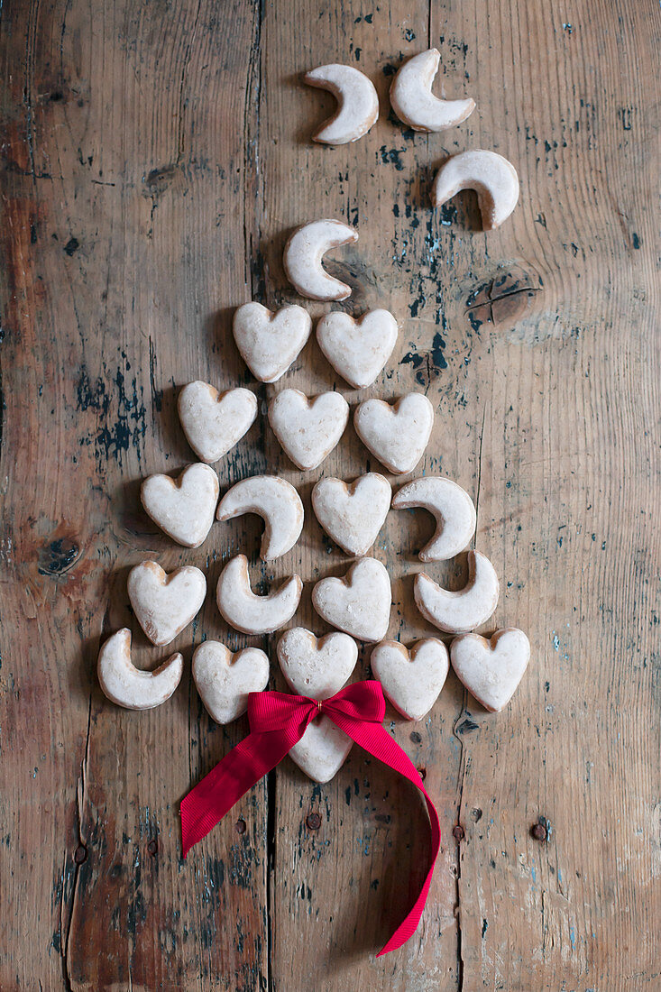 Heart-shaped and crescent biscuits arranged in the shape of a Christmas tree
