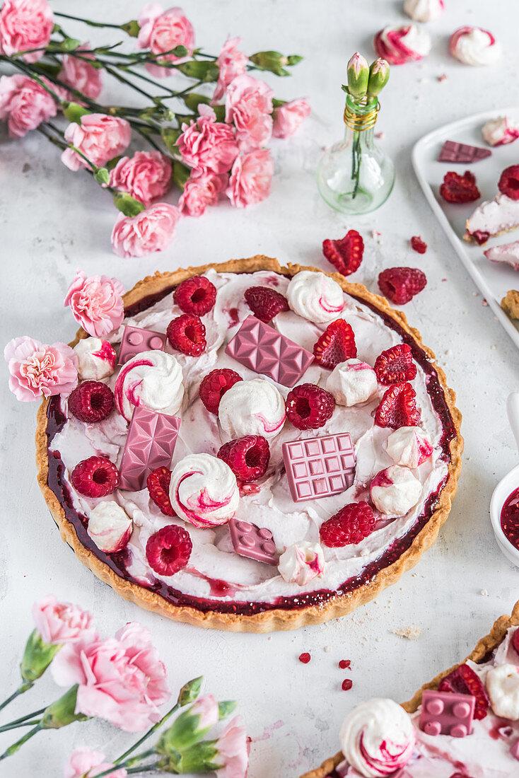 Raspberry tart with mascarpone, ruby chocolate and meringues
