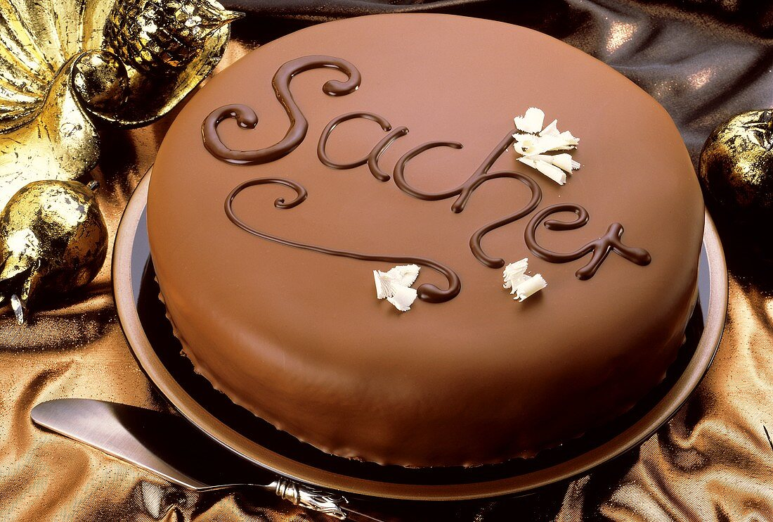 """Sacher torte with the word """"Sacher"""" in chocolate"""