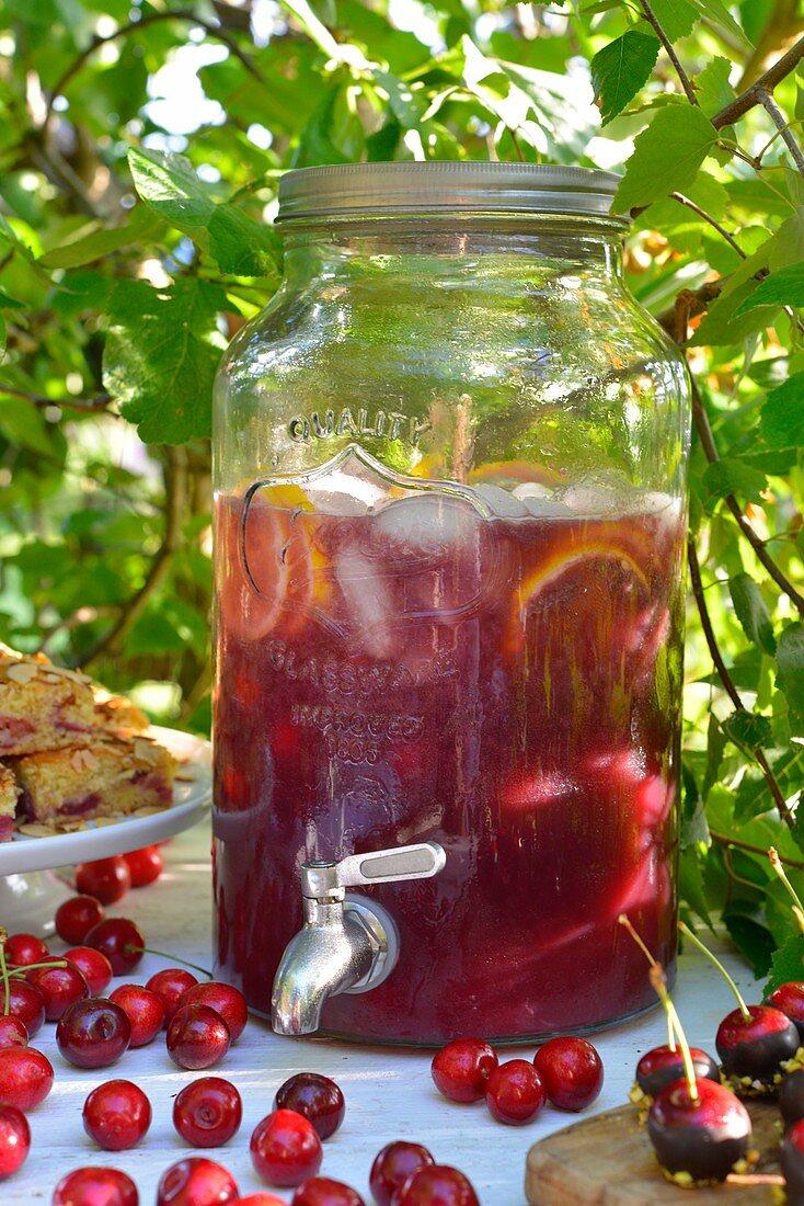 Homemade cherry lemonade in a drink dispenser