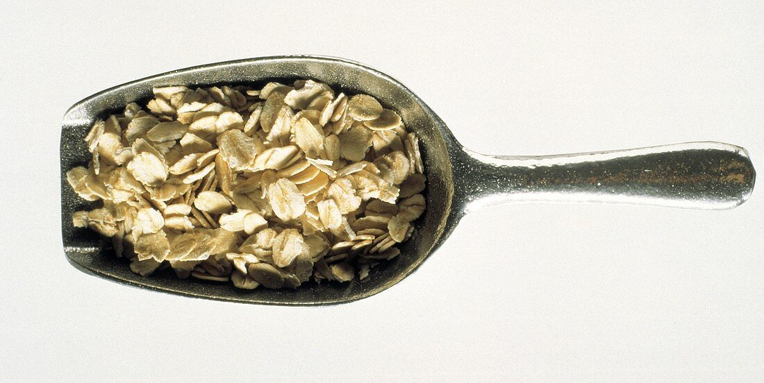 A Metal Scoop Filled with Oat Flakes