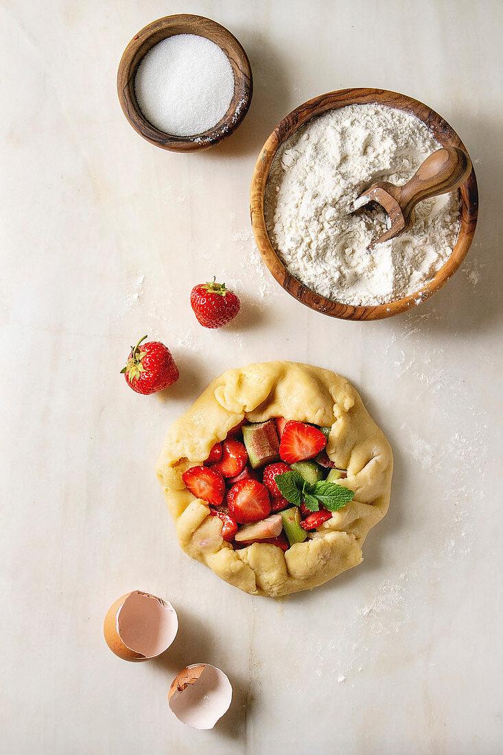 Process of baking summer berry biscuit pie