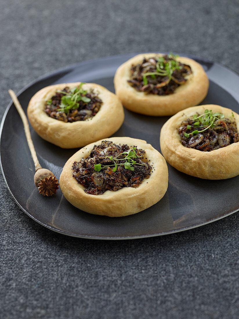 Mini poppyseed and onion tarts