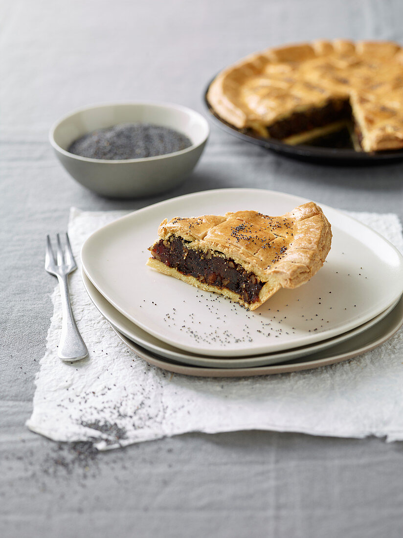A poppyseed and apple pie with dried apricots