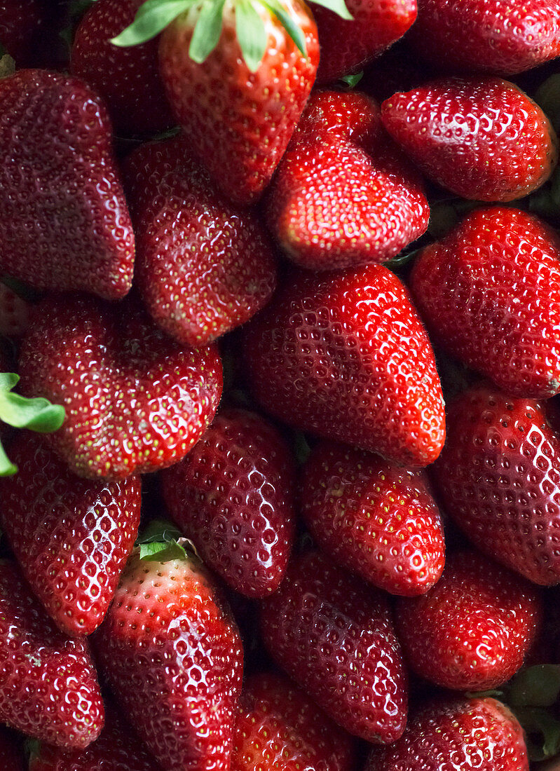 From above clean healthy ripe strawberries placed in pile