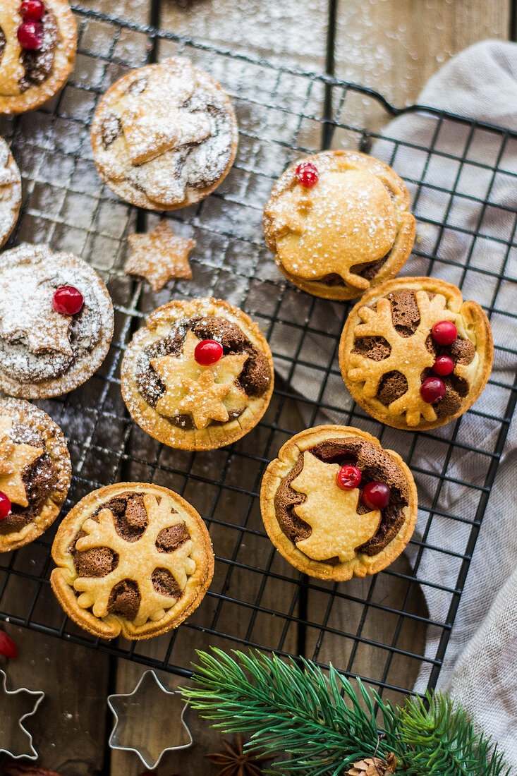 Making Christmas tarts with nut filling