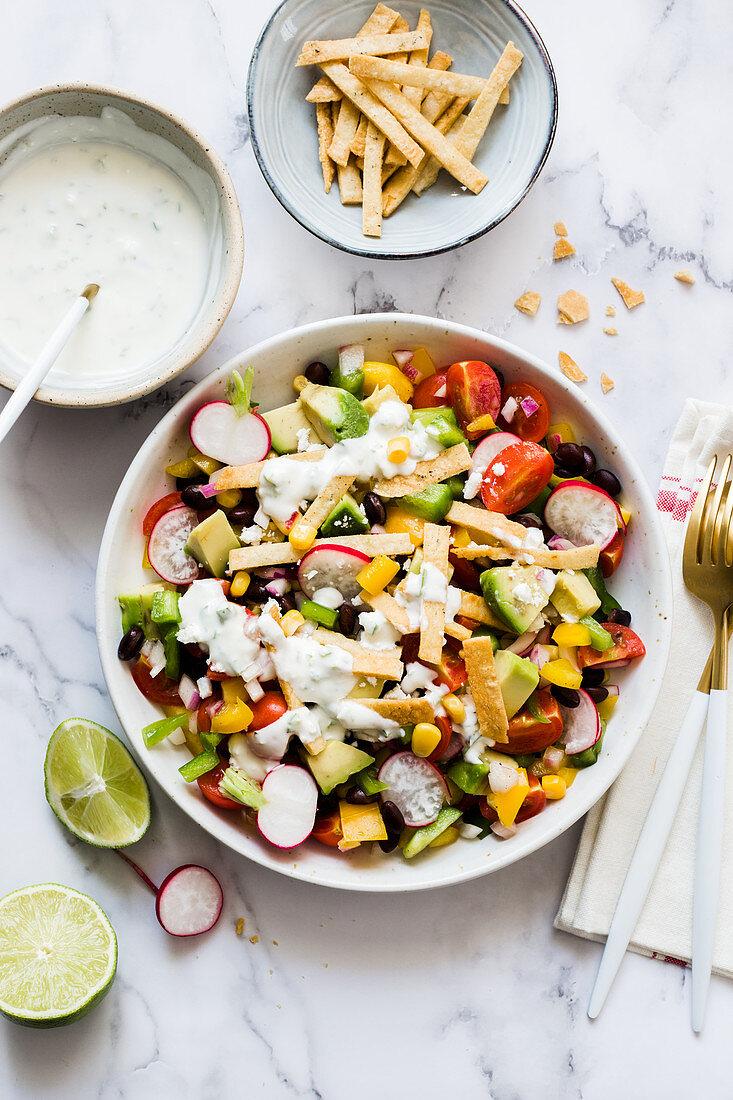 Vegan taco salad with avocado, black beans, corns