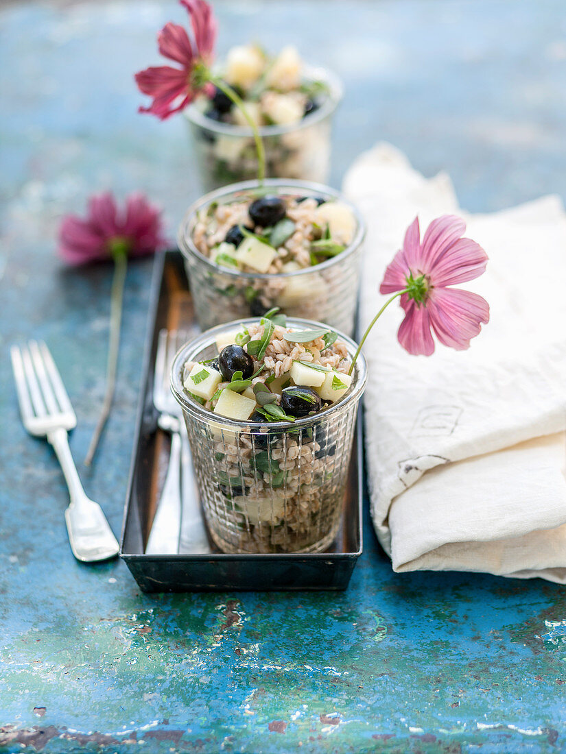 Farro salad (spelt salad) with pecorino and black olives