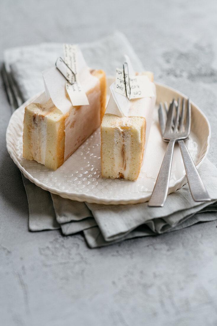 Sponge cake ice cream sandwich with almonds and cream