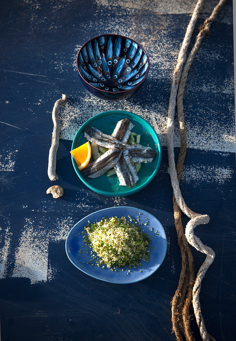 Raw anchovies with marinated cucumbers and couscous