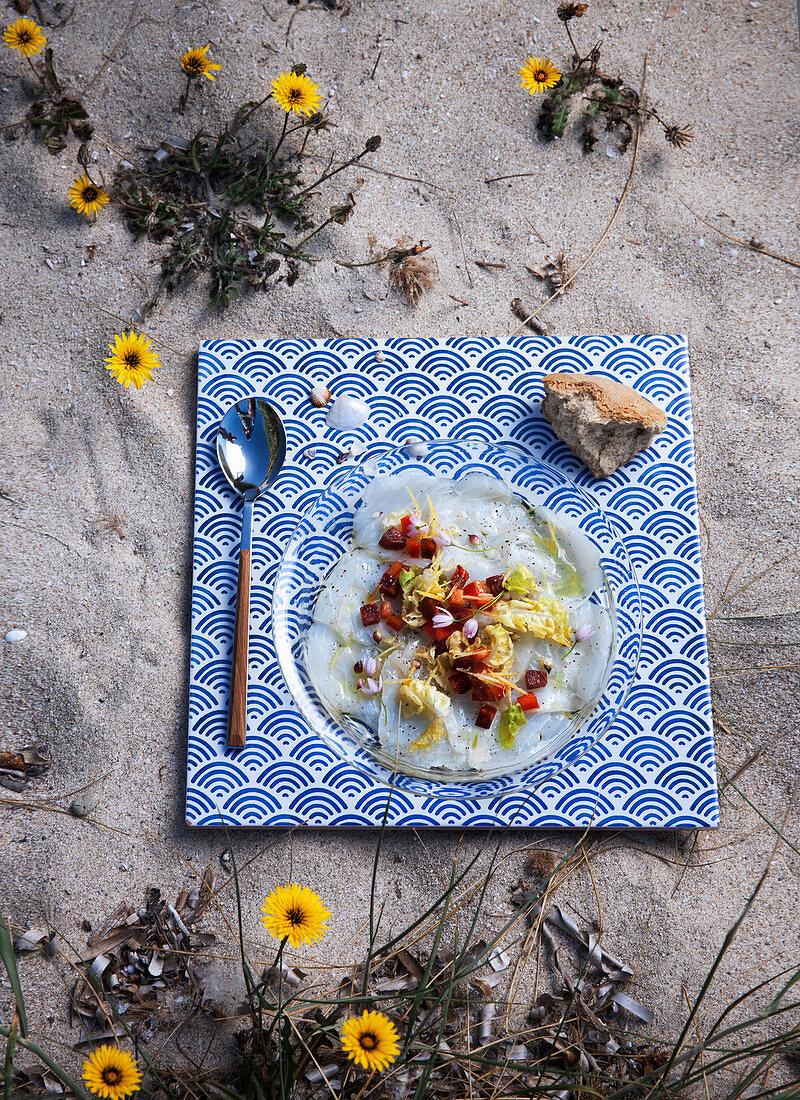 Cod carpaccio with salami and Romaine lettuce