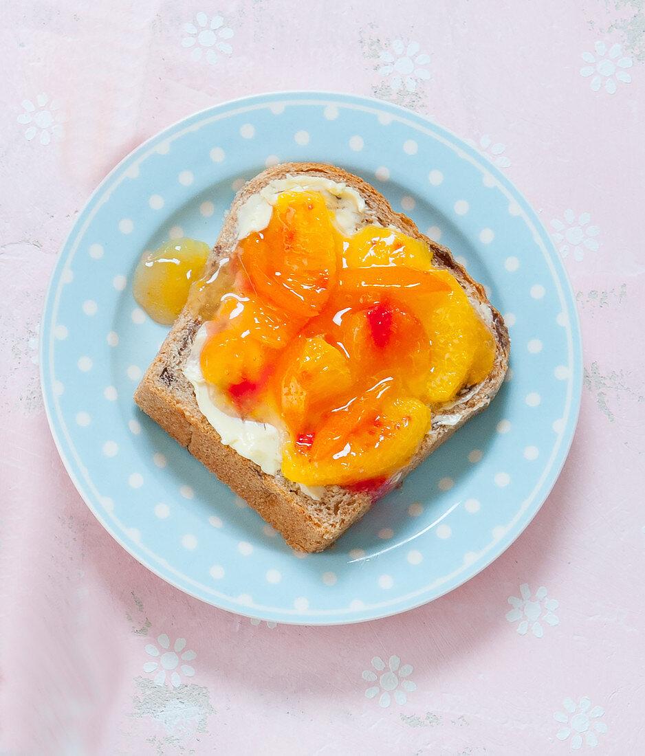 Peach and orange marmalade on a slice of white bread