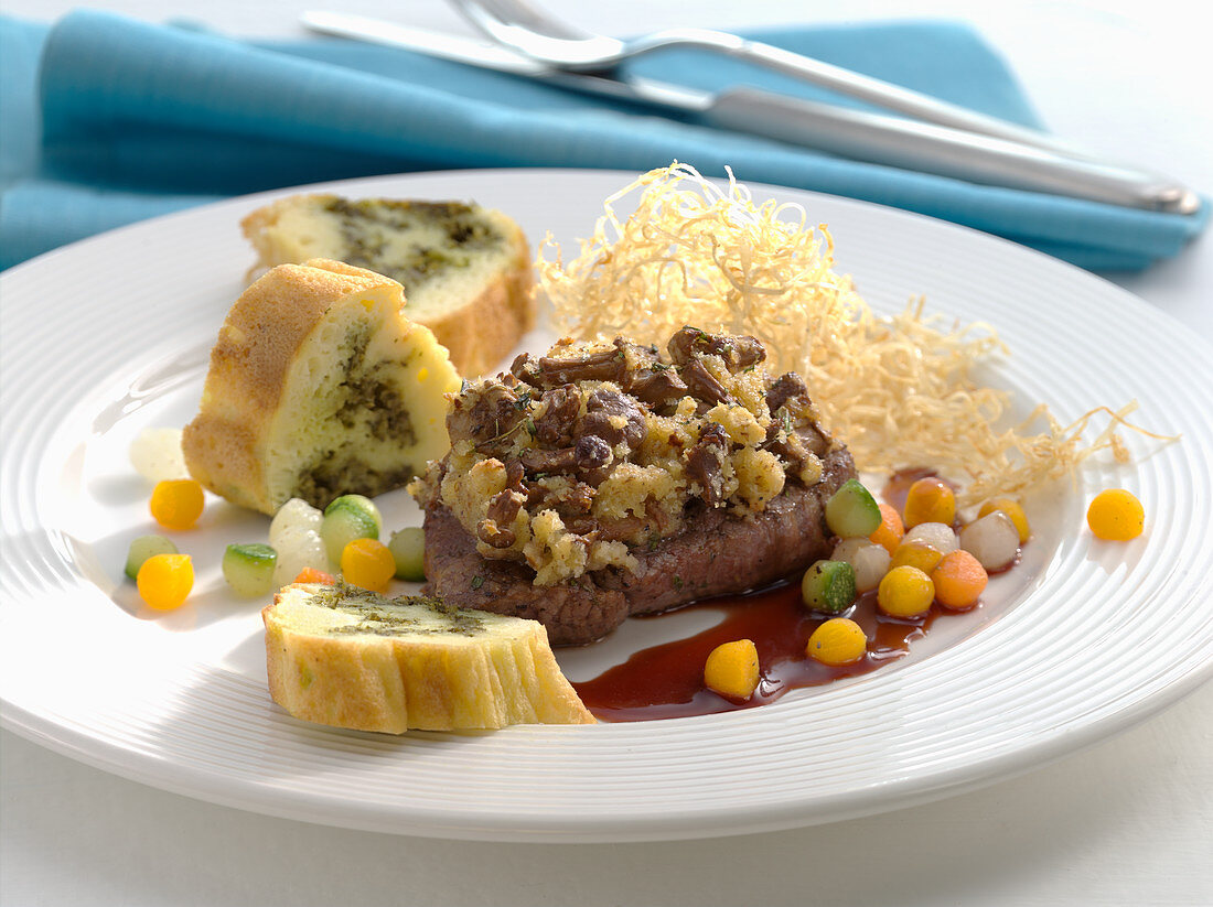 Ostrich fillet with chanterelle crust, celery straw, and potato pesto roulade