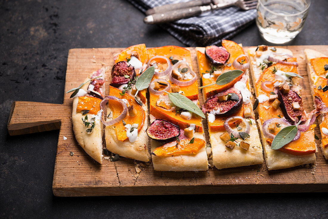 Vegan tarte flambée with pumpkin, figs and smoked tofu