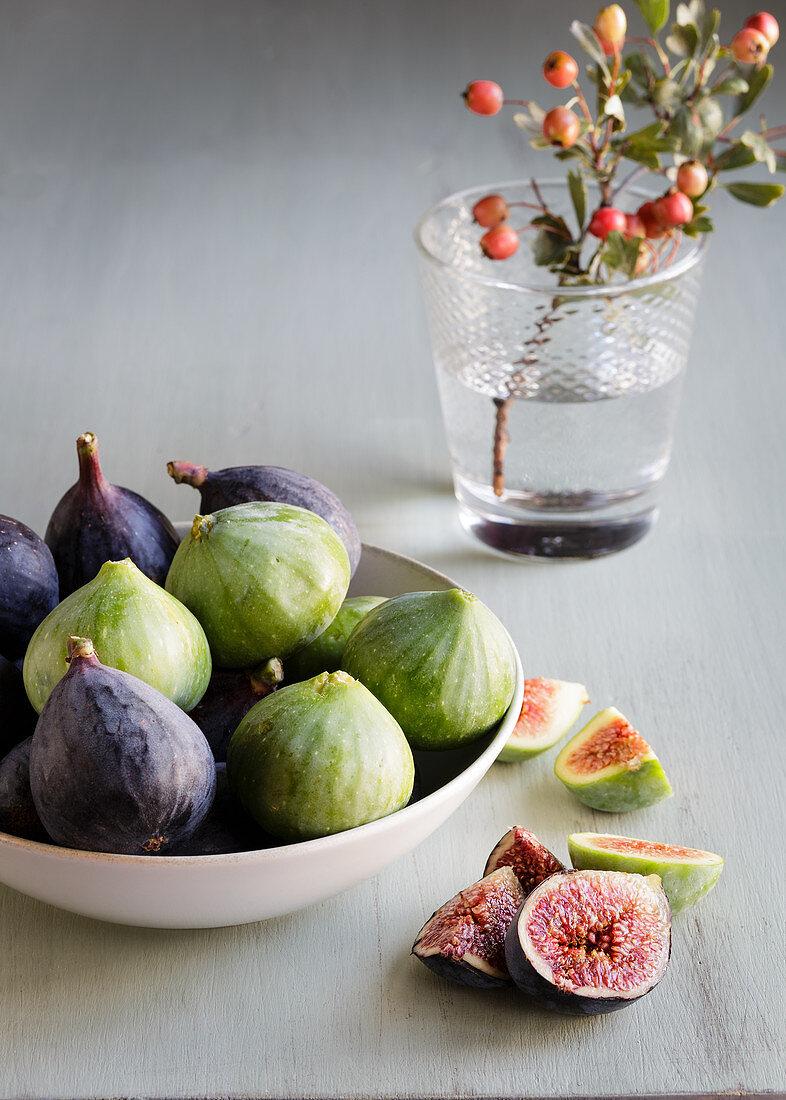 Plate of fresh ripe figs on kitchen table