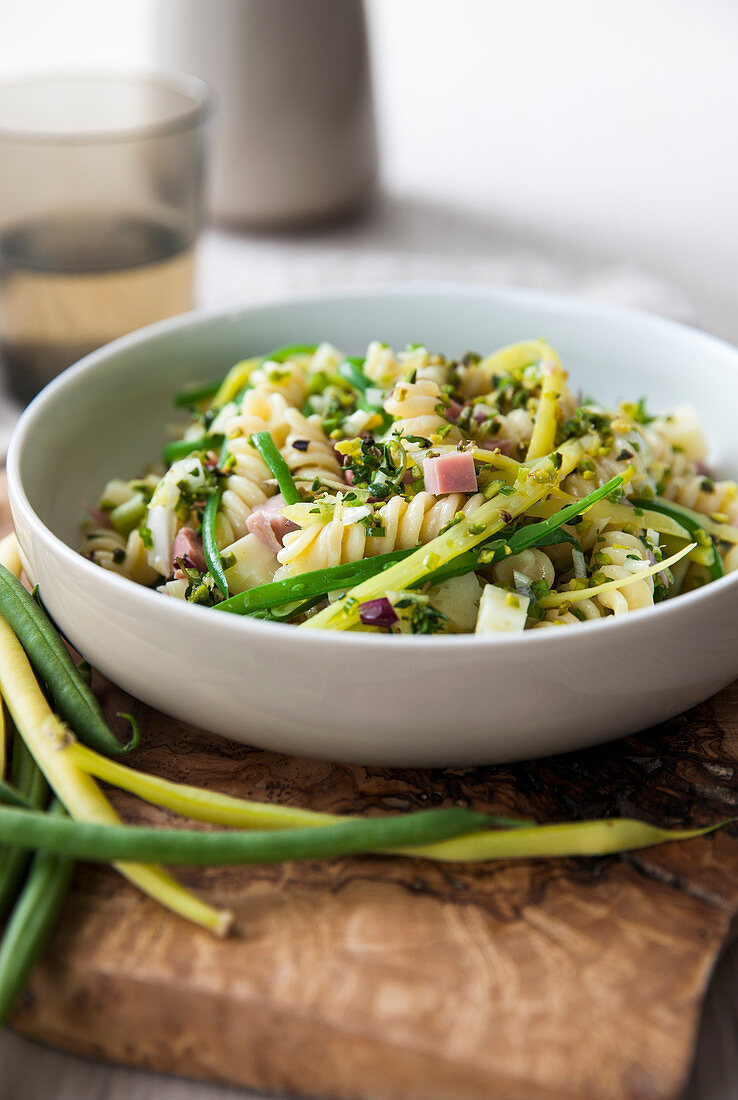 Fusilli with green and yellow beans, ham and pecorino