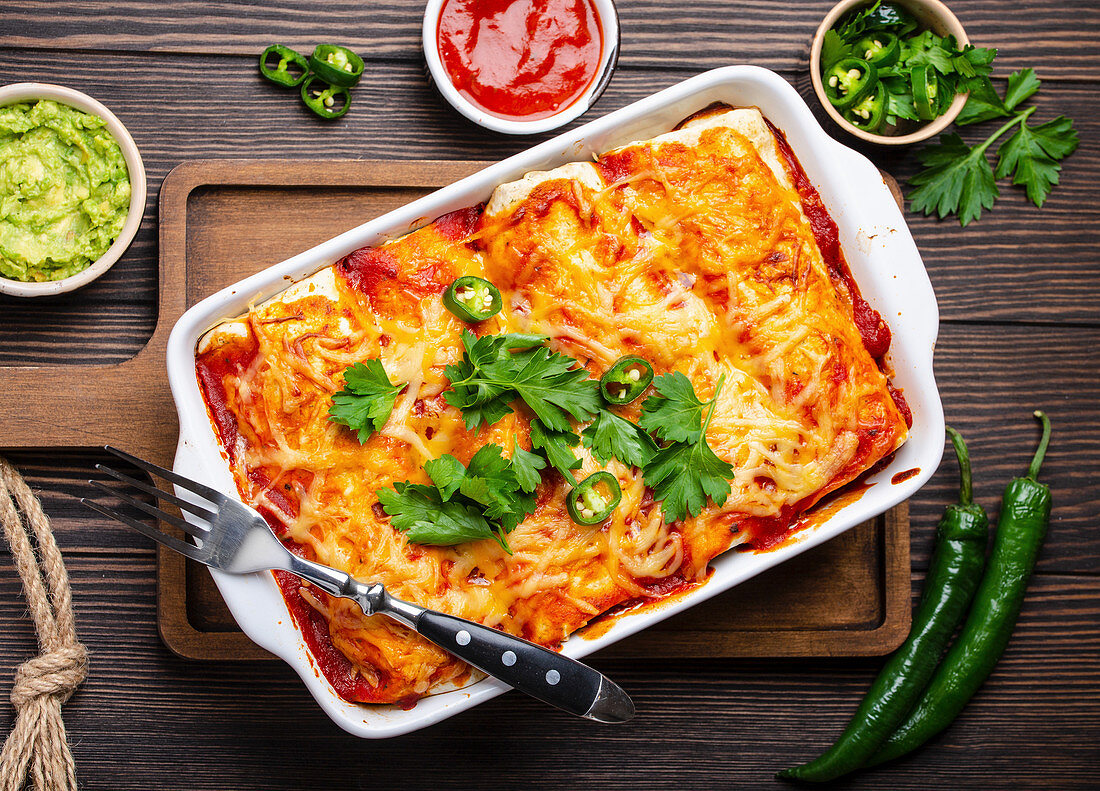 Traditional Mexican enchiladas with meat, chili red sauce and cheese