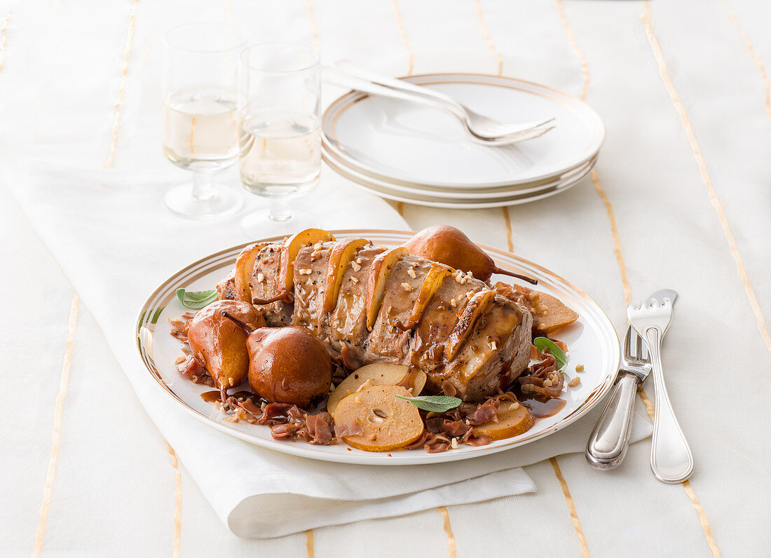 Veal fillet with pears and walnut and ham crumbles