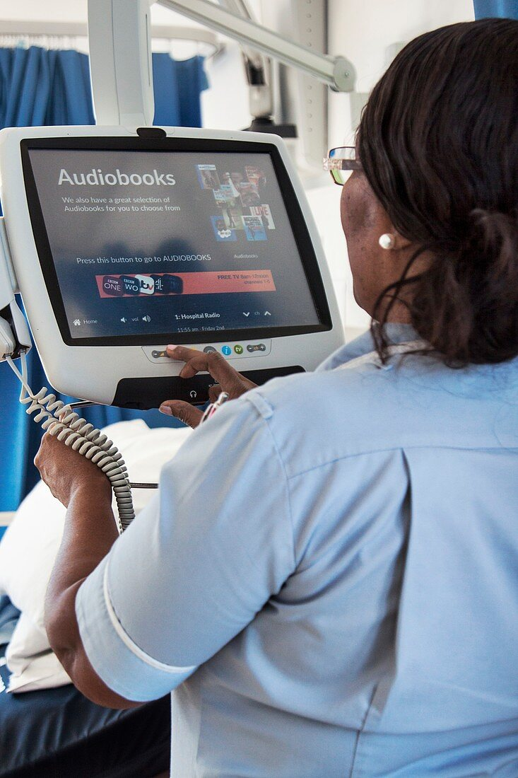 Healthcare assistant selecting an audiobook