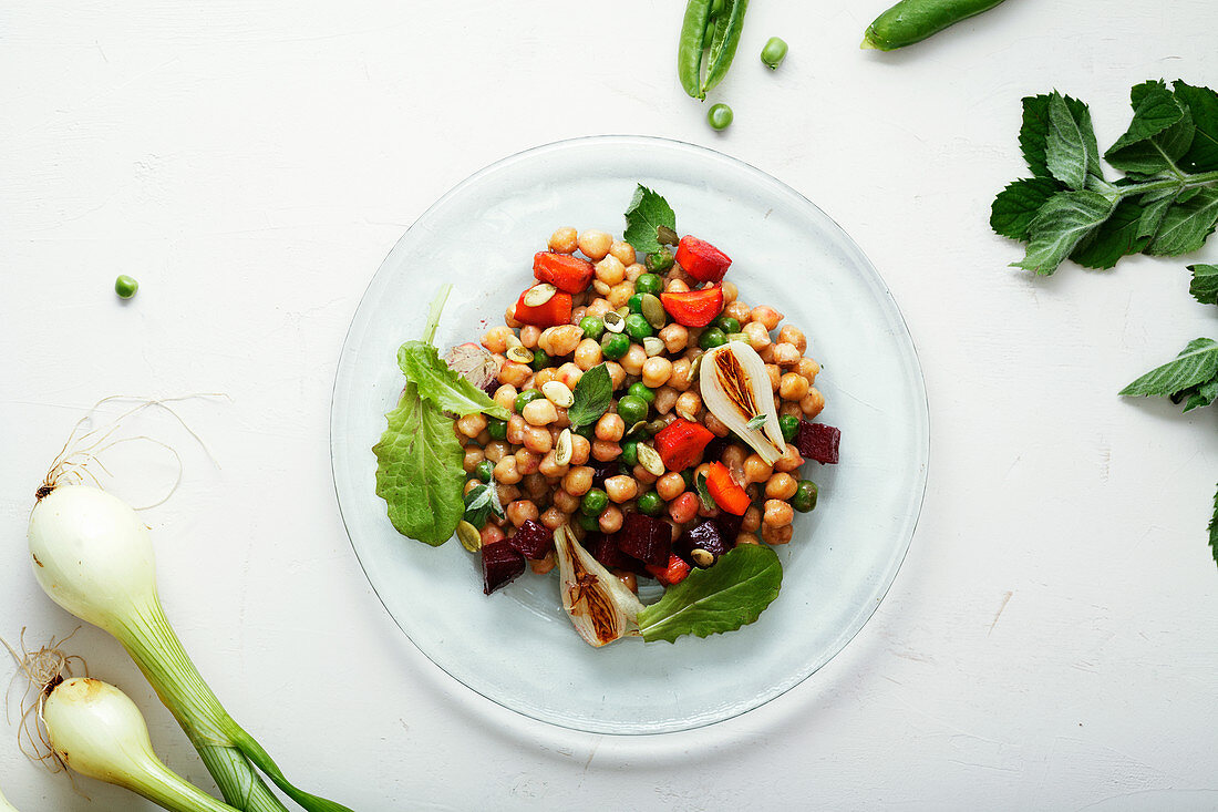 Fresh chickpea salad with mint and vegetables