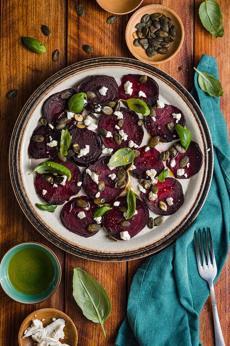 Beets carpacio with feta cheese, fresh basil, pumpkin seeds and olive oil