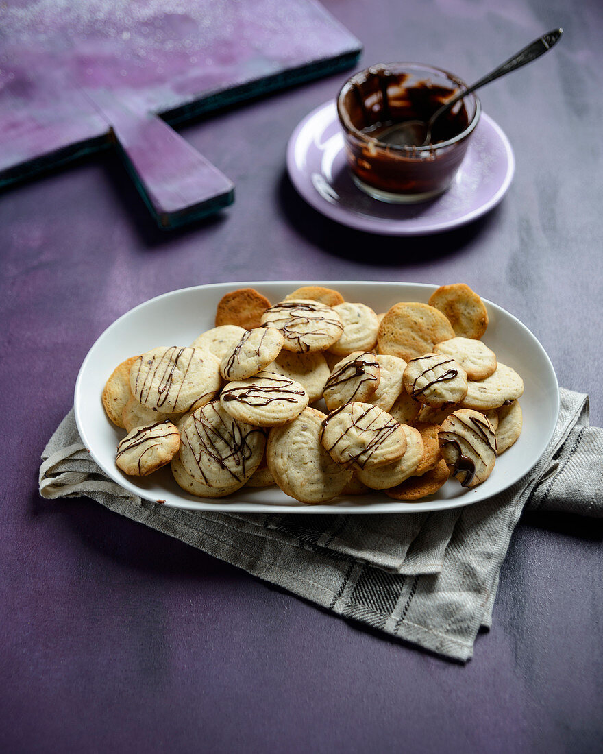 Vegan stacciatella piped biscuits decorated with chocolate