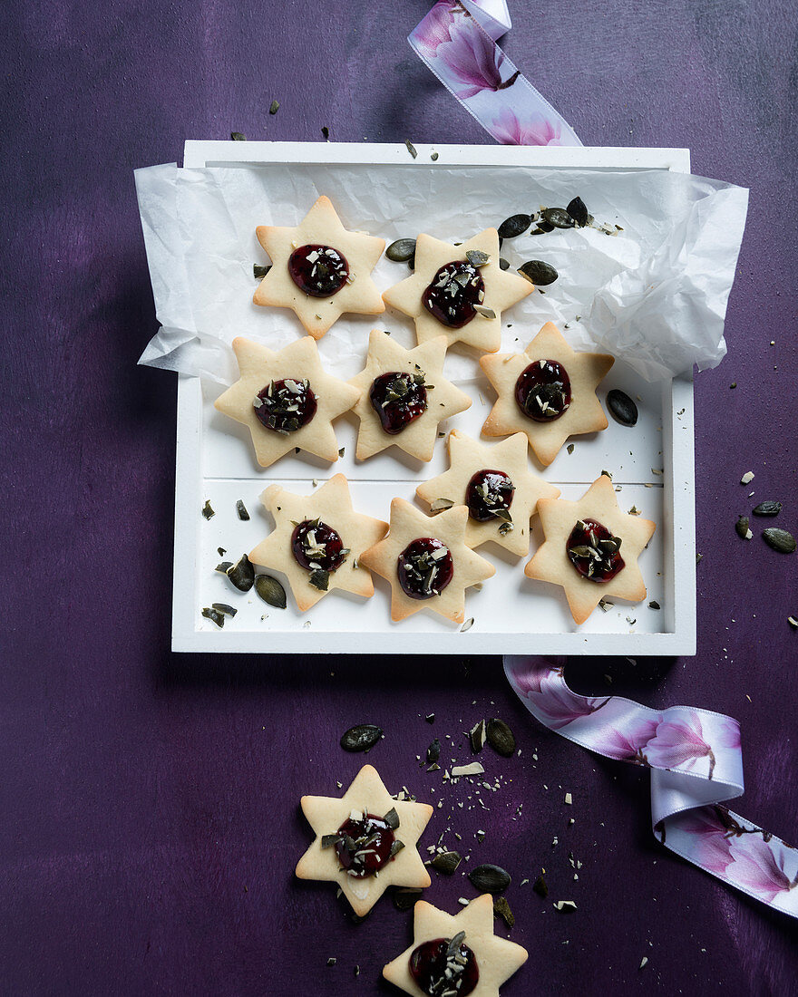Vegan vanilla stars with redcurrant and apricot jam and pumpkin seeds