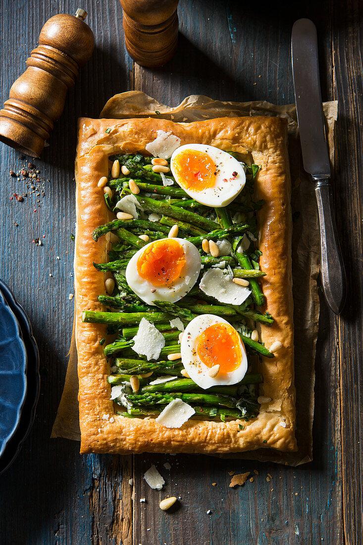 Vegetarian asparagus tart with pinenuts and parmesan