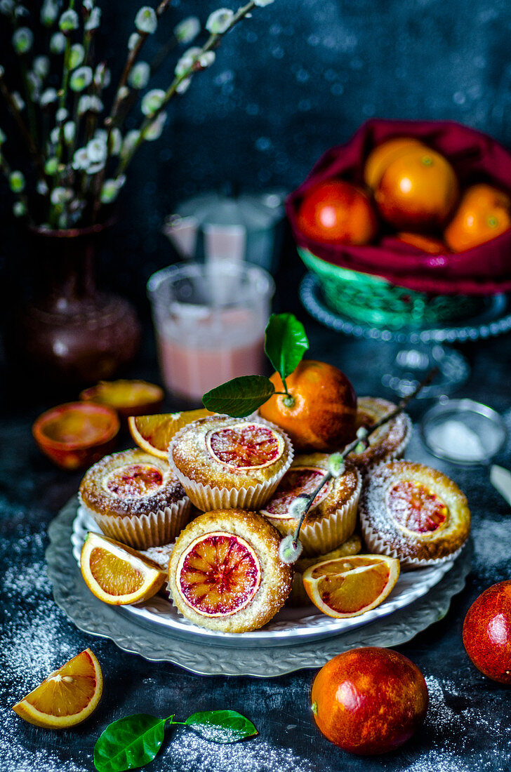 Muffins with slices of red orange