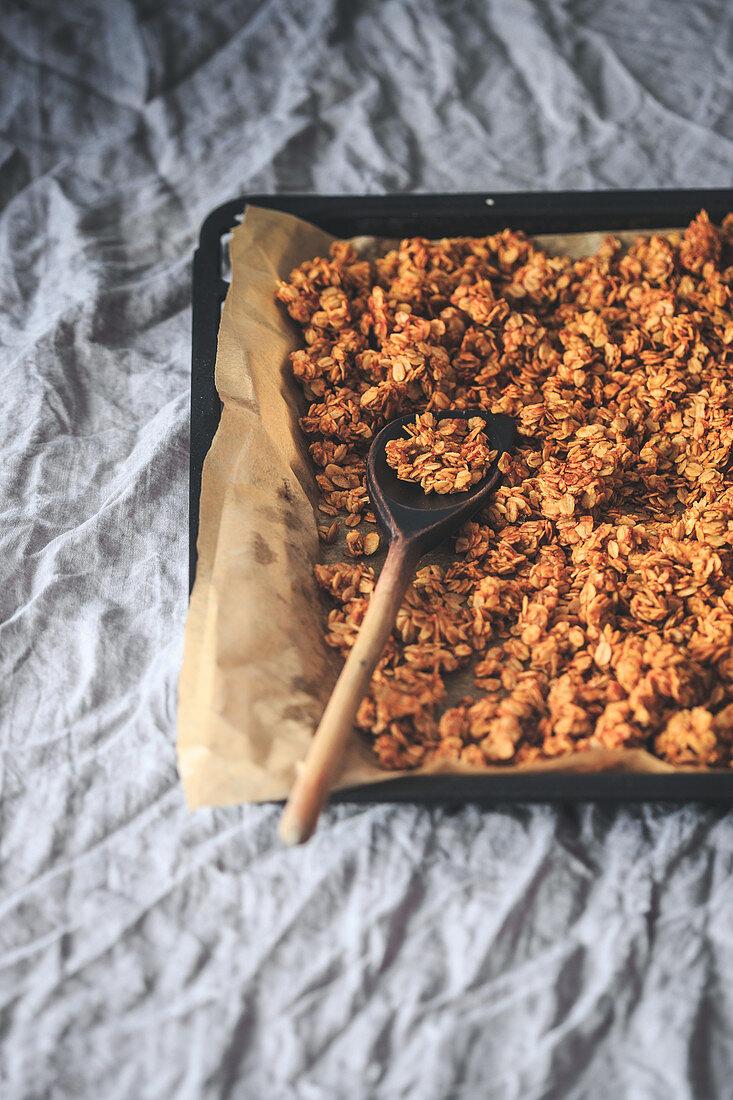 Homemade granola on a baking tray
