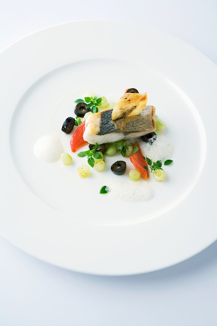 Grilled sea bass on marinated cucumber pearls