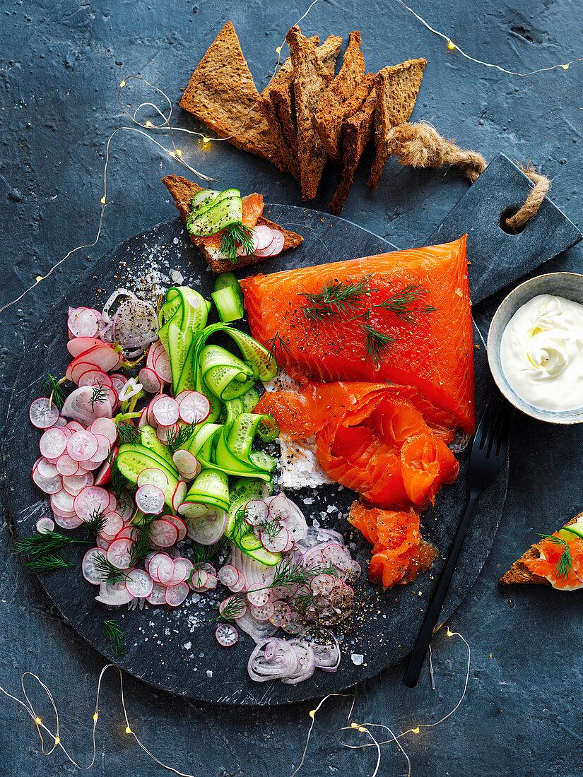 Salmon Gravlax Platter with cucumber and radish