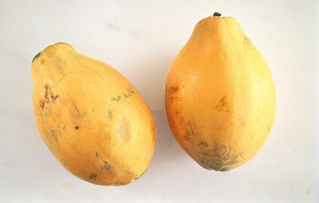 Two Whole Papayas