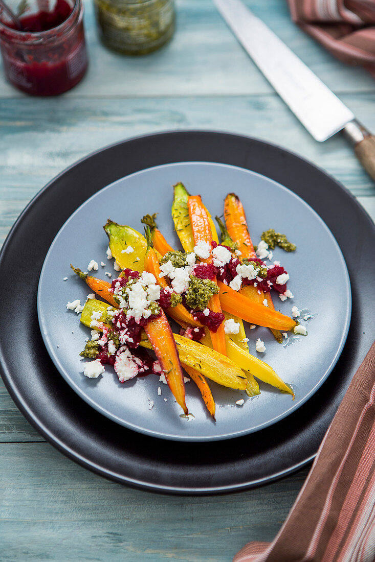 Colourful roasted carrots with pesto and feta cheese