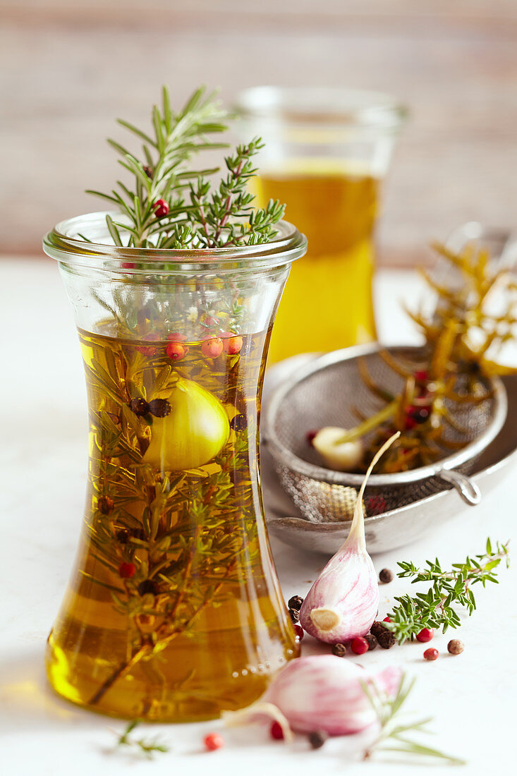 Homemade herb oil from South Africa with pink pepper, garlic, rosemary and thyme
