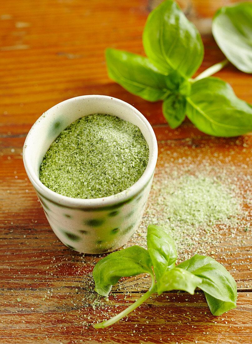 Homemade herb salt with fresh basil, rock salt and garlic
