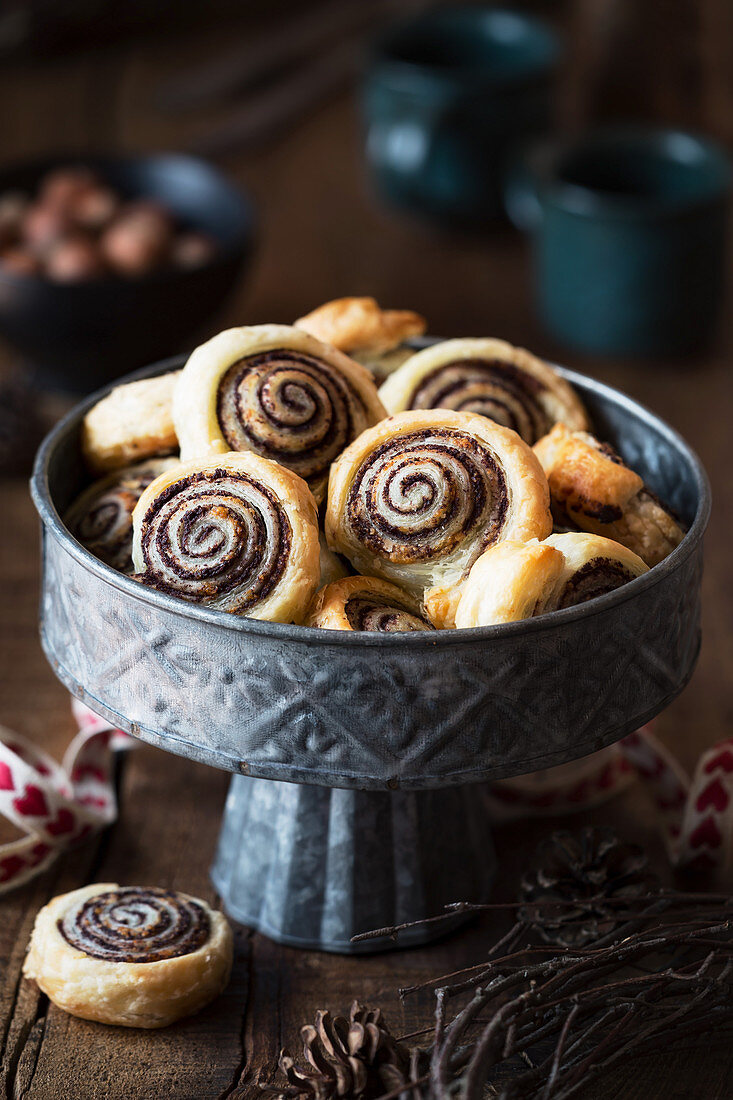 Puff pastry swirls filled with tapenade or black olive spread and parmesan cheese