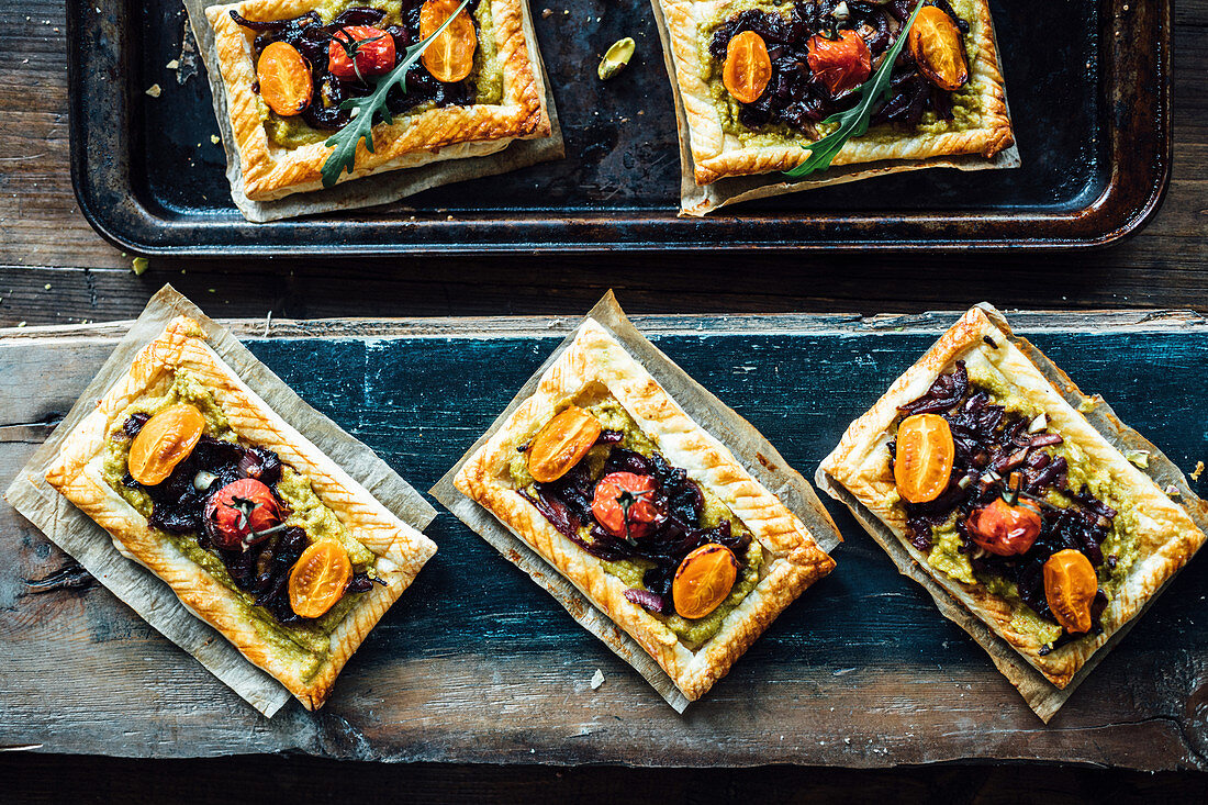 Crisp pastry base smothered with a paste of ground nuts and coconut milk