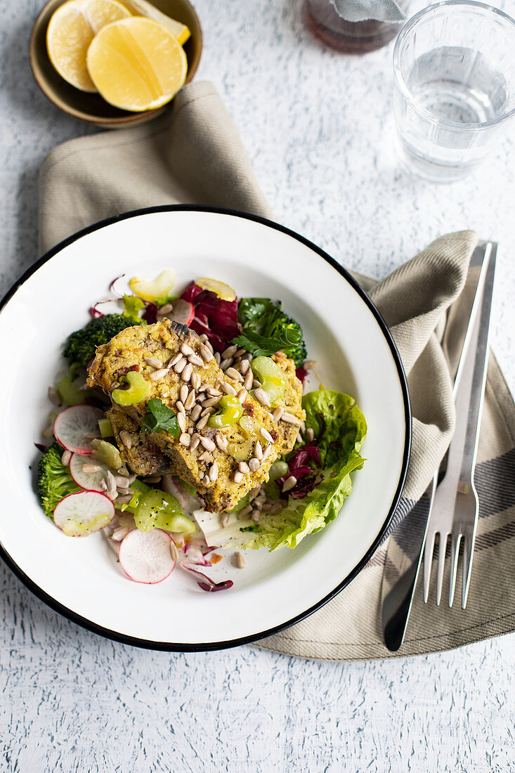 Vegetable terrine with salad and sunflower seeds