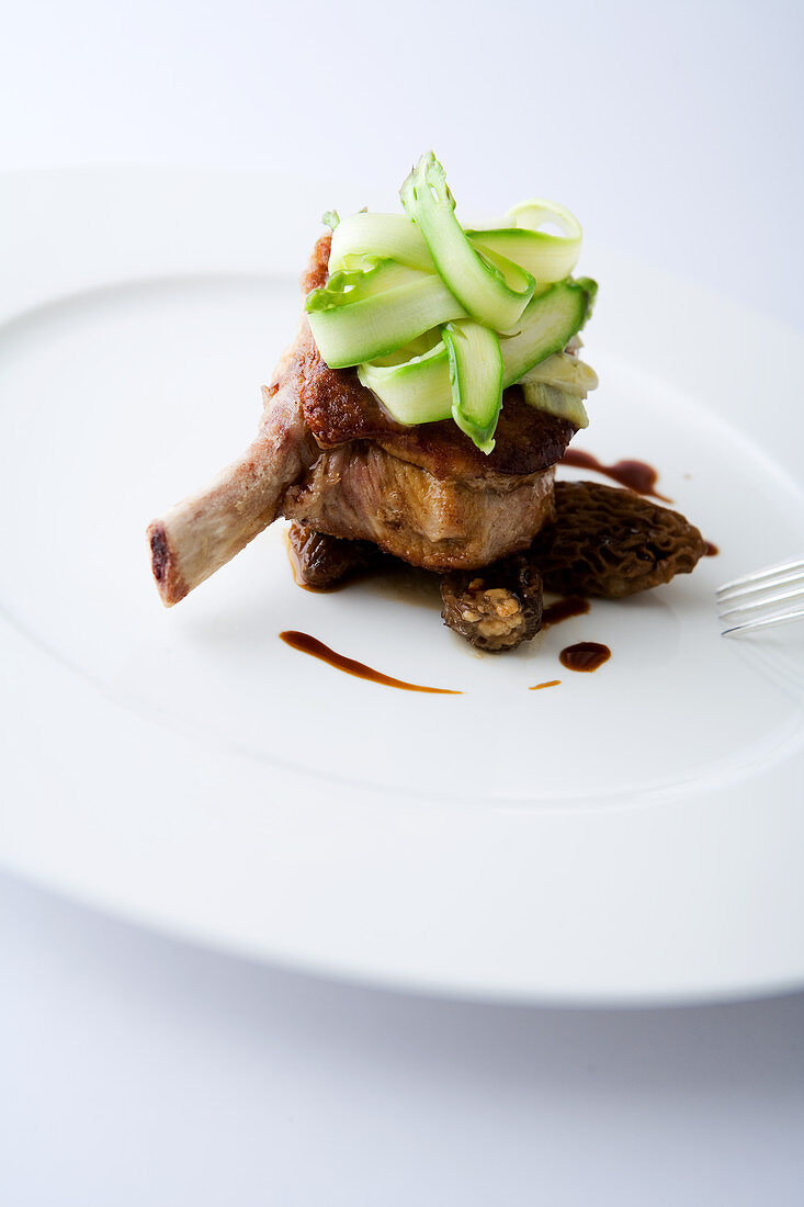 Veal chop with asparagus shavings and morels