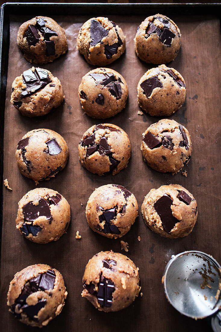 Cookie dough with chocolate on a baking sheet