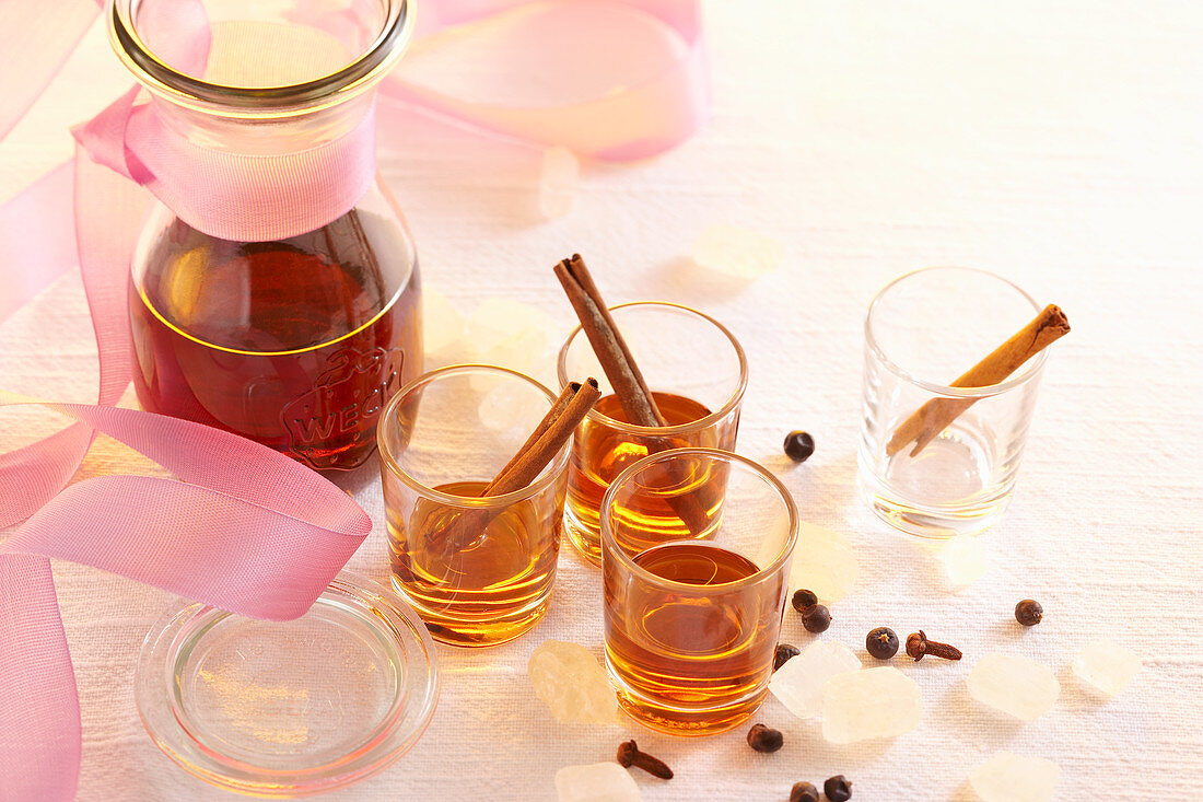 Homemade spiced liqueur with cinnamon sticks