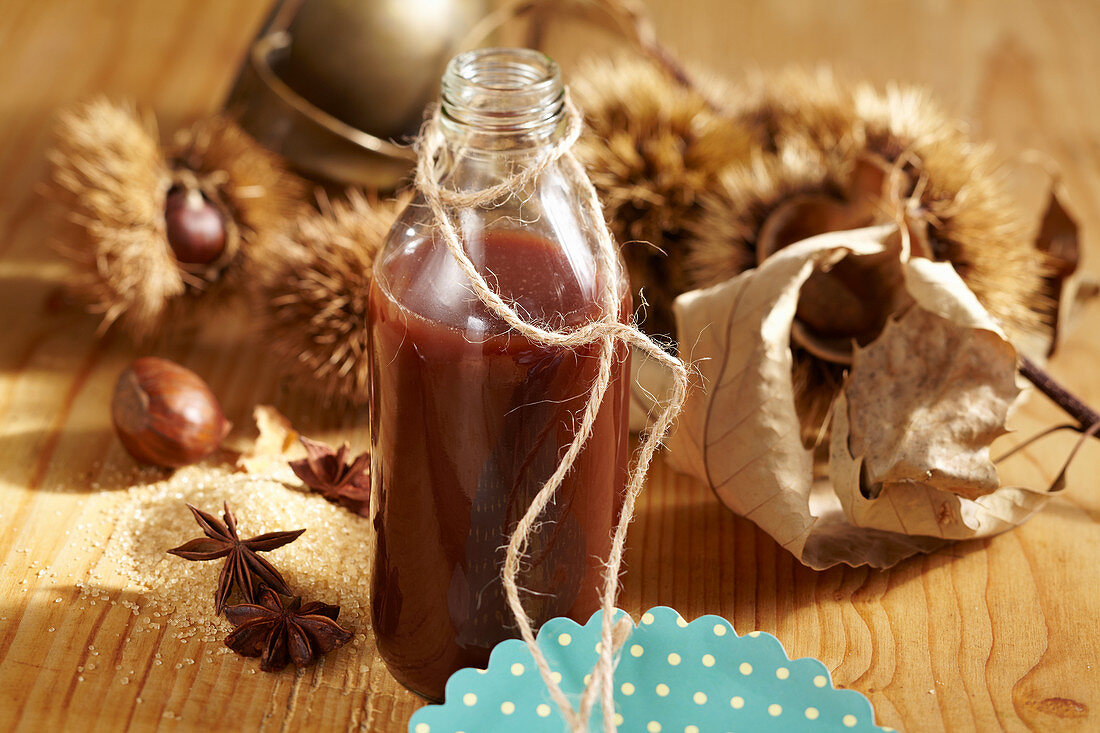 A bottle of homemade chestnut liqueur with cocoa and vodka