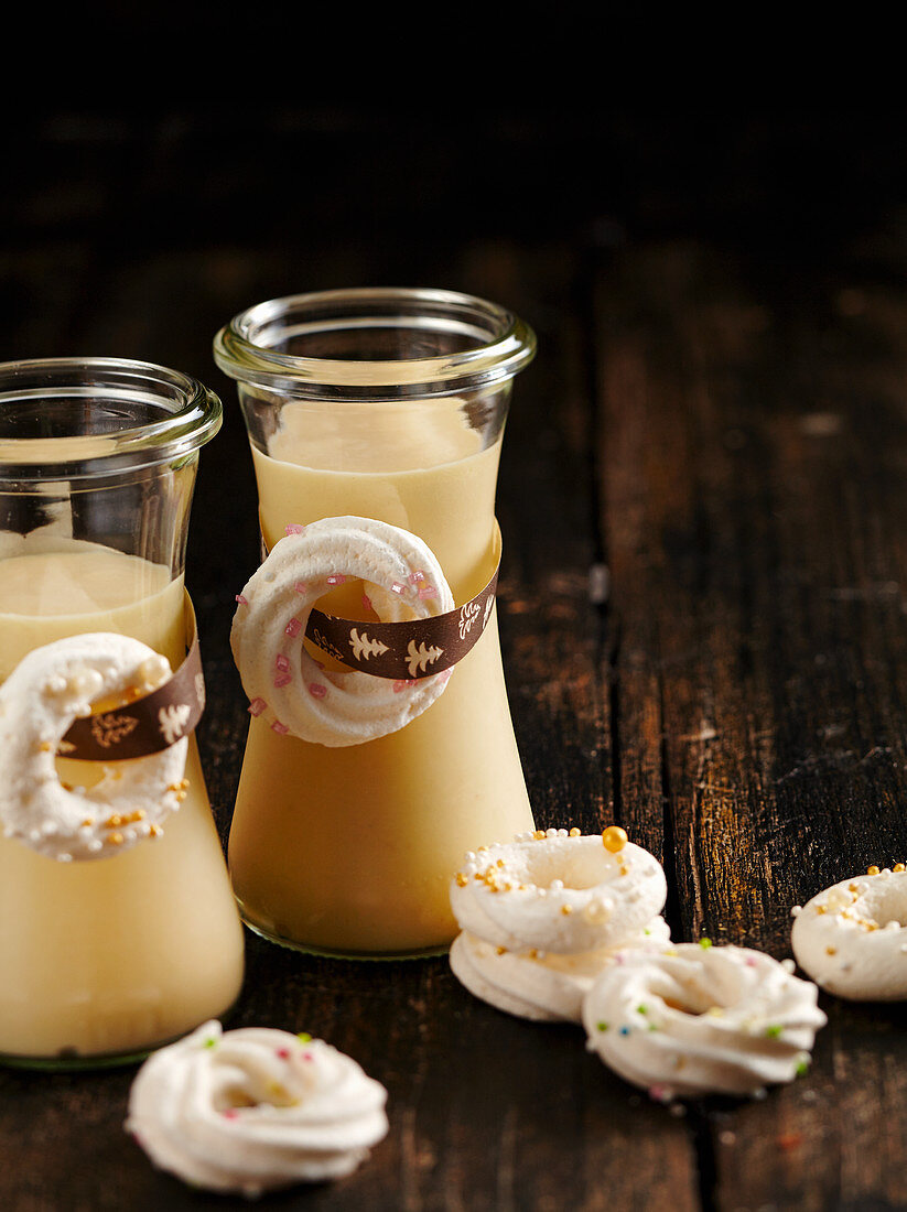 Homemade white chocolate liqueur decorated with meringue rings